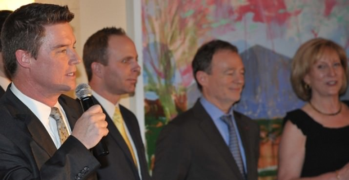 Russ Lewis announces a raffle winner – left to right – Russ Lewis of KGW Newschannel 8, Robert Bourrier of Delta Air Lines (the official airlines sponsor of the event), Bernard Lehucher from the Consulate of France in San Francisco, and Françoise Aylmer, the French Honorary Consul for the State of Oregon