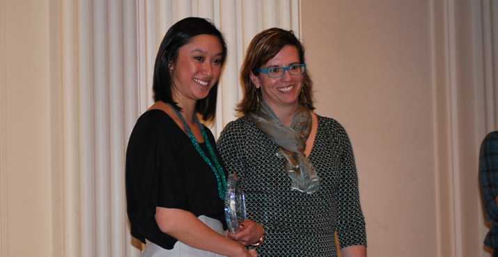 Amanda Ip, Special Projects Coordinator at Fred Meyer, congratulates Adrienne Karecki from Central City Concern. The Volunteer Corps from Central City Concern won the Volunteer Innovation Award