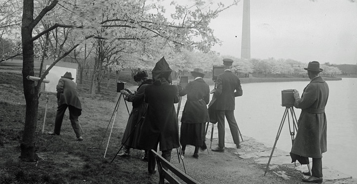Photographers shooting cherry blossoms along the Tidal Basin in Washington, D.C. on April 4, 1922.