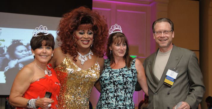 Carolyn Steward and Kay Lynn Myers are crowned Queens of Sole by emcee Poison Waters and Board President Harlan Barcus