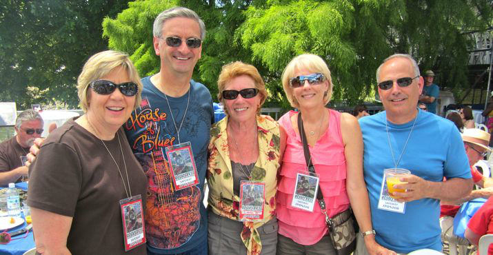 The Safeway crew poses together! Mona Person, Ron Person, Syd Hanigan, a board member, and Cheryl and Bob Helleman helped contribute to the success of the 25th Annual Waterfront Festival