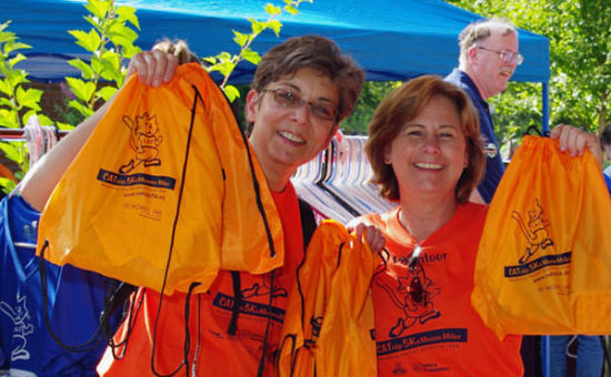 CAT staffers help out – Pamela and Liz offer participants one of our awesome swag bags.