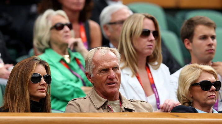 Greg Norman, Australian golfer, and his wife Kirsten Kutner (L) watch the men's singles Tennis match between Andy Murray of Great Britain and Stanislas Wawrinka of Switzerland on Day 2 of the London 2012 Olympic Games in Wimbledon.