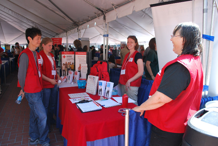 American Red Cross volunteer recruiters had the trademark red vests!