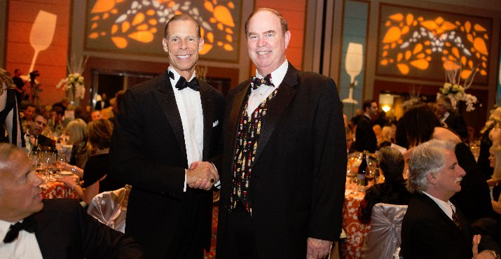 George Hosfield, CIO, Ferguson Wellman Capital Management and CWA Board Chair, congratulates fellow CWA Board member and 2013 Auction Co-Chair, Keith Barnes of Barnes Capital Management on the successful event.