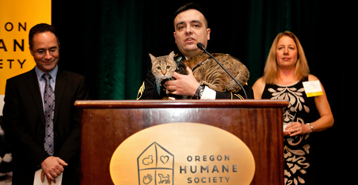 From left emcee Matt Zaffino with Diamond Collar Hero Winner Sgt. Jesse Knott and his cat Koshka the he rescued from Afghanistan with OHS Executive Director Sharon Harmon cheering him on.