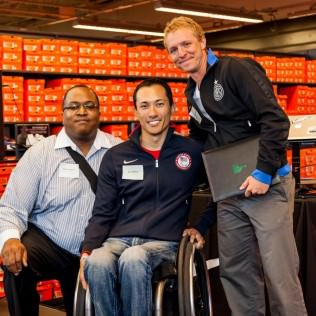 Nike Paralympian Gold Medalist and rugby wheelchair athlete Will Groulx with grant recipient representatives Andre Ashley, Sports Management Supervisor, Portland Parks & Recreation and Kaig Lightner, Director of Coaching, Portland Community Football Club. Grant: To launch the Portland Community Football Club, a community-based soccer club emphasizing the principles of equal access to sport and diversity, and providing affordable, high-quality soccer for Portland youth.