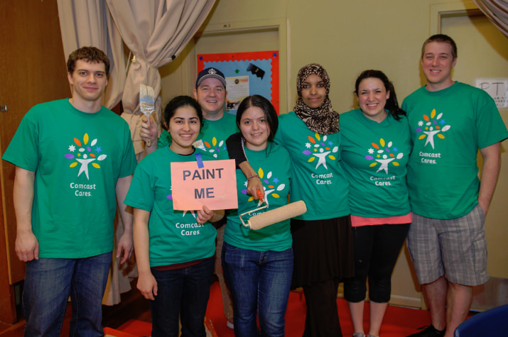 Girls Inc. of NW Oregon volunteers join Cares Day at Faubion School for some painting. Pictured: Zane Grout, Connor Music (in the back), Sadaf Assadi, Florisela Herrejon, Fardowsa Idris, Lauren Munoz-Tremblay and Rob Bush. Photo by Andie Petkus.