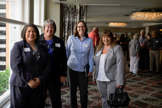 (L) Annette Campista, Vice President and Planning Committee member poses with attendees