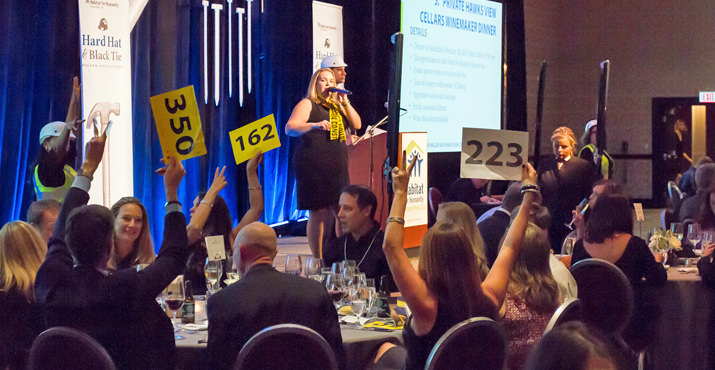 Auctioneer Kelly Russell gets the Live Auction roaring
