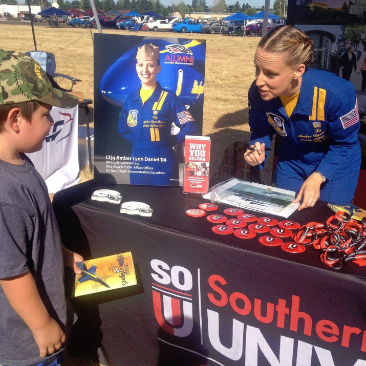 Public Affairs Officer, Lt. Amber Lynn Daniel, @SouthernOregonUniversityAlumniAssociation is signing autographs at the University's booth
